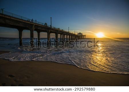 Sunset on the pier in Manhattan Beach, California - stock photo