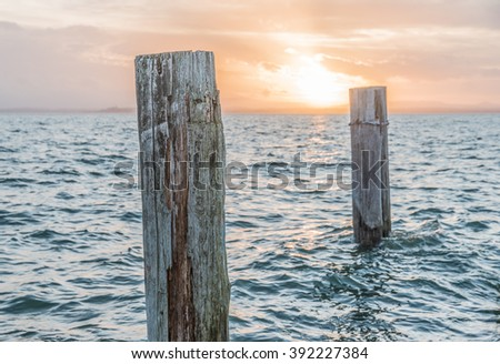 Sunset on the pier of Lake Trasimeno, Umbria - Italy - stock photo