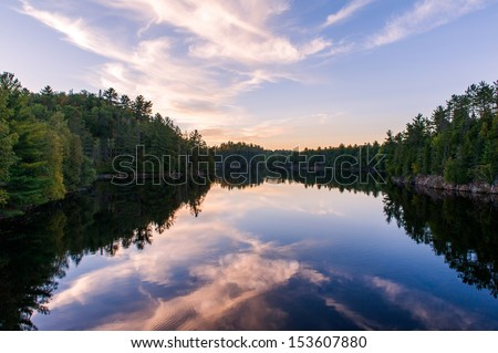 Sunset on the river and the forest in Canada