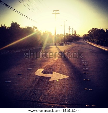 Sunset on the road - stock photo