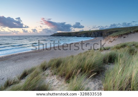 Sunset on the sand dunes at Holywell Bay near Newquay in Cornwall - stock photo