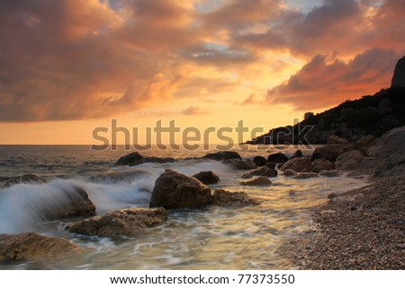 Sunset on the sea shore - stock photo