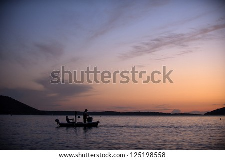 Sunset on the sea with a boat