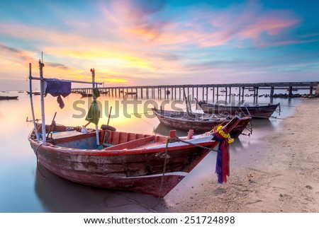 sunset on the sea with a boat at Bangpra beach chonburi,thailand - stock photo