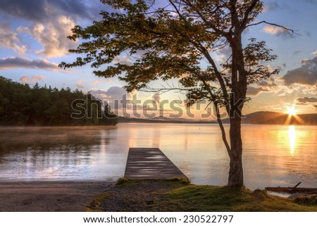 Sunset on the shore of Seventh Lake in the Fulton Chain Lakes region of the Adirondack Mountains of New York