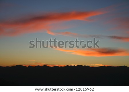 Sunset on the top of mountain in Southern Alps, South Island, New Zealand