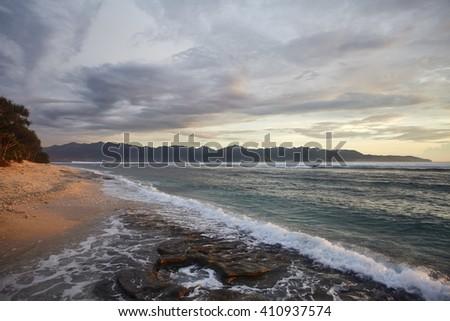 sunset on the tropical beach - stock photo
