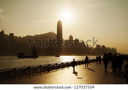 Sunset on the Tsim Sha Tsui Promenade (Avenue of the Stars) in Hong Kong - stock photo