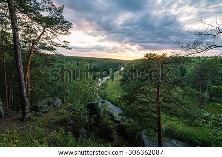 sunset on the Ural river with rocky shore, Russia, Ural