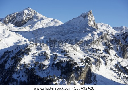 sunset on the western slope of the peak Peyreget, 2483 meters, Ossau Valley, Pyrenees, France - stock photo