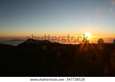 Sunset on top of Mauna Kea in Hawaii, near the observatories - stock photo