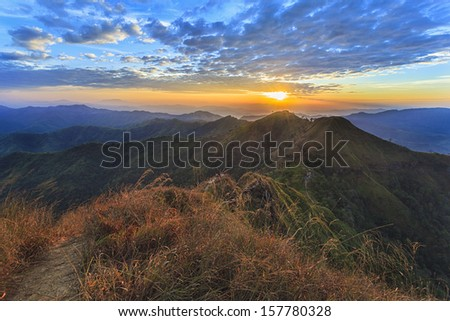 Sunset on top view of mountain - stock photo