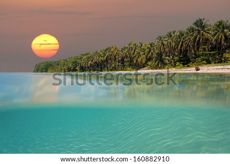 Sunset on tropical beach island with underwater view,  Caribbean sea, Bocas del Toro, Panama - stock photo