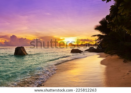 Sunset on tropical beach Source D'Argent at Seychelles - nature background