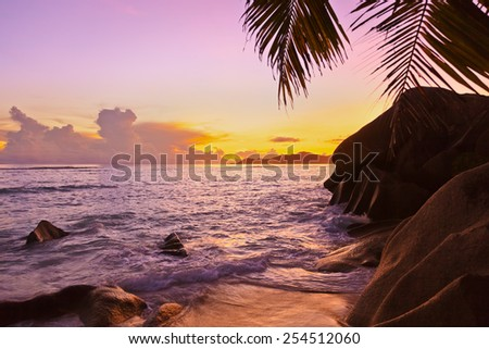Sunset on tropical beach Source D'Argent at Seychelles - nature background - stock photo