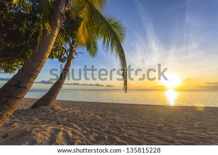 Sunset on tropical Fiji island - stock photo