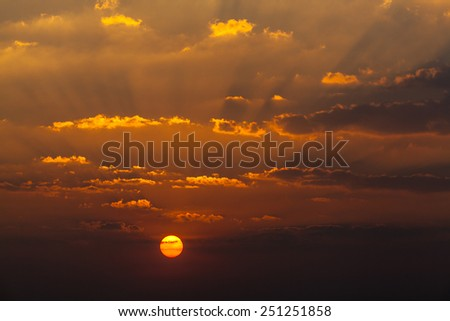 Sunset or sunrise with rays of light through the sky - stock photo