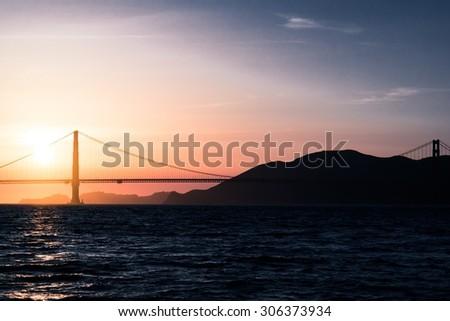 Sunset oven Golden Gates bridge, - stock photo