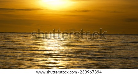 Sunset over a calm ocean in the Philippines - stock photo
