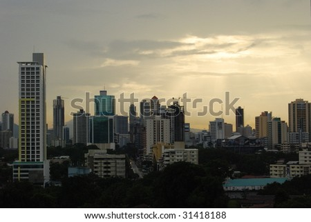 sunset over a city in central america