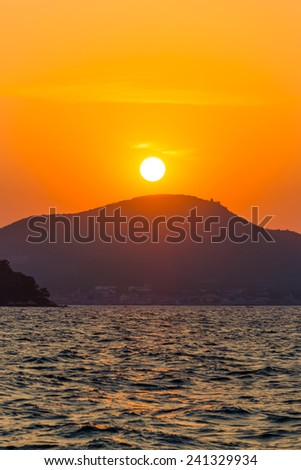 Sunset over a Koh Lan island in Thailand - stock photo