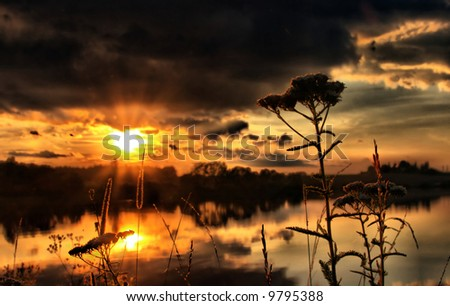 sunset over a lake - stock photo