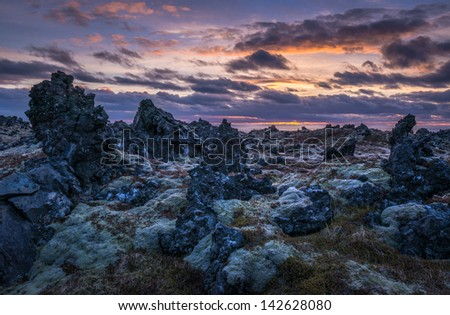 Sunset over a lava field on the Icelandic coast