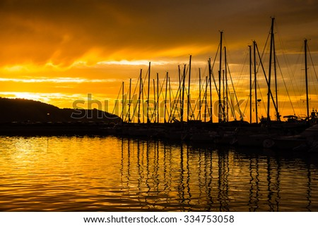 sunset over a marina  - stock photo