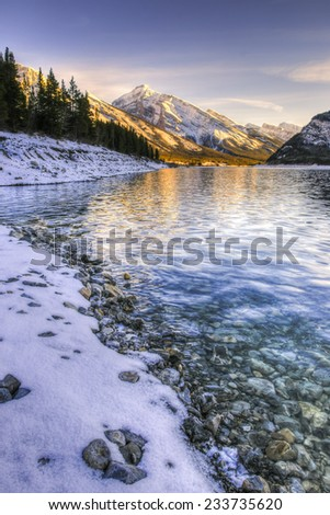 Sunset over a mountain lake in early winter, Kananaskis Country Alberta Canada