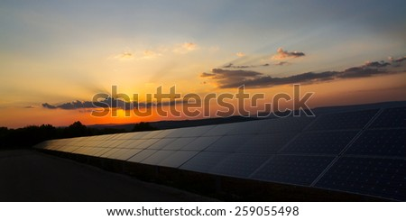 Sunset over a photovoltaic power plant - stock photo