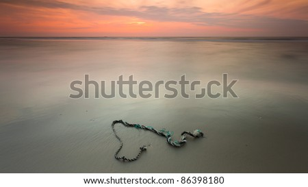 Sunset over a rope - stock photo