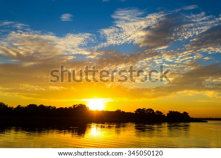 sunset over a small lake - stock photo
