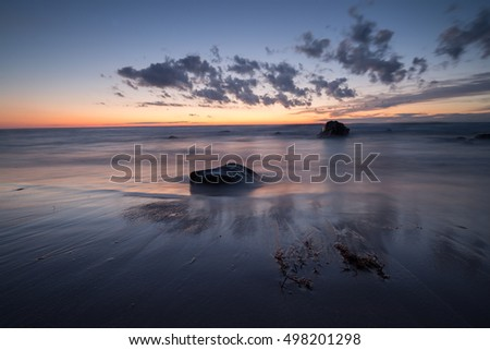 Sunset over a swedish beach at the national park of gotska sandon photographed with long exposure