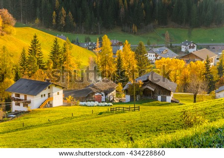 Sunset over a Traditional Farm in the Alps in Autumn - stock photo