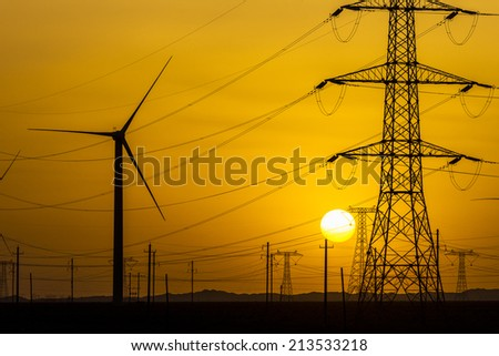 sunset over a windfarm, Sinkiang china. - stock photo