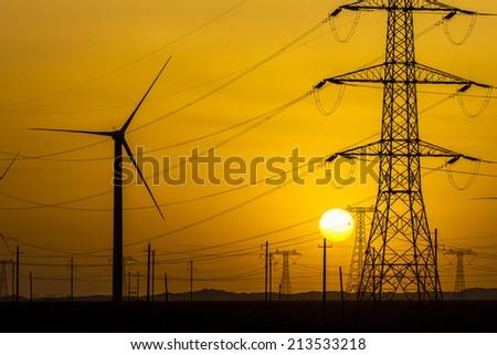 sunset over a windfarm, Sinkiang china. - stock photo
