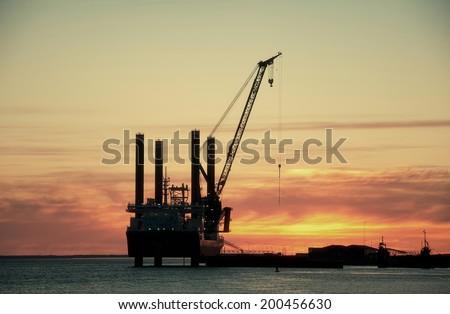 Sunset over an industry harbour with cranes