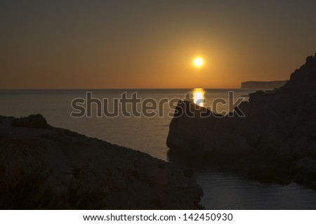 Sunset over Anchor Bay, Mellie?a, Malta - stock photo