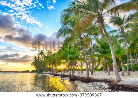 Sunset over Anse Champagne beach in Saint Francois, Guadeloupe, Caribbean