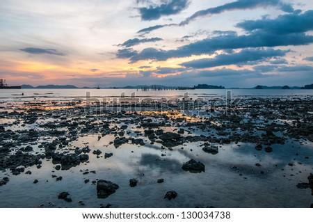 Sunset over Ao Nang beach, Krabi province, Thailand - stock photo