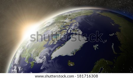 Sunset over Arctic region on planet Earth viewed from space with Sun and stars in the background. Elements of this image furnished by NASA. - stock photo