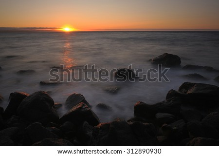 Sunset over Arctic Sea, northern Iceland. - stock photo