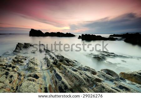 sunset over Atlantic coast - stock photo