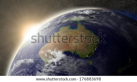Sunset over Australia region on planet Earth viewed from space with Sun and stars in the background. Elements of this image furnished by NASA. - stock photo