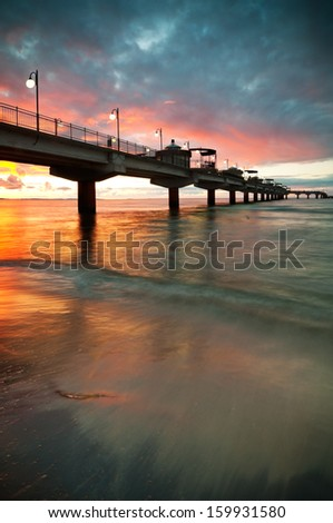 Sunset over Baltic Sea and pier in Miedzyzdroje, Poland, Europe - stock photo