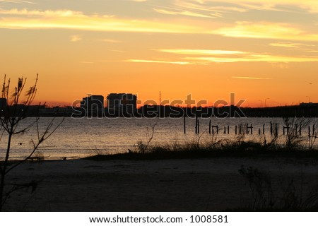 Sunset over bay after Hurricane Katrina. - stock photo