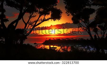 Sunset over beautiful lake region - stock photo