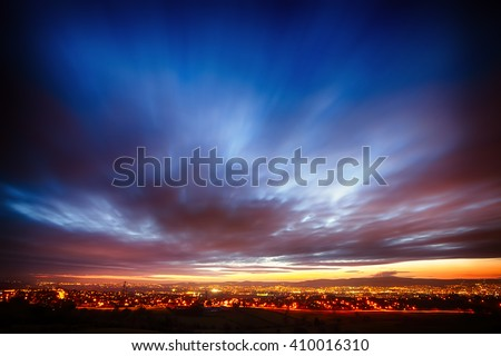 Sunset over Belfast, Northern Ireland, from the Castlereagh Hills - stock photo