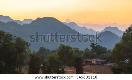 Sunset over big mountain in Thailand - stock photo