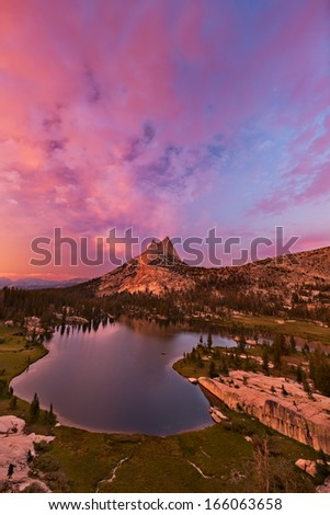 Sunset over Cathedral Peak and Cathedral Lake in Yosemite National Park.   - stock photo